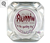 Milton Prell's Aladdin Hotel / Las Vegas, / Nevada ''on the sparkling strip'' Phone: 736-0111 - Maroon on white imprint Glass Ashtray