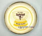 Newt Crumley's Holiday, Mug Hunt, 1961 - Brown and yellow imprint Porcelain Ashtray